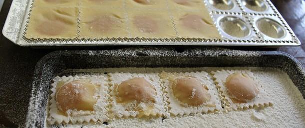 Preparing the finished ravioli for freezing.