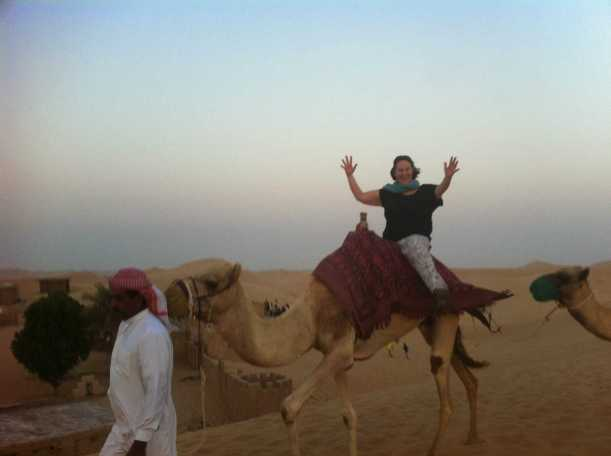 Molly Moynahan camel riding sans hands during her teaching assignment in Abu Dhabi.
