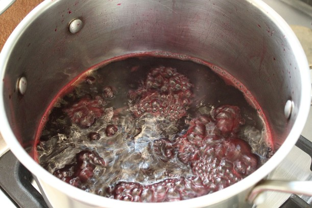 Simmering pomegranate juice.
