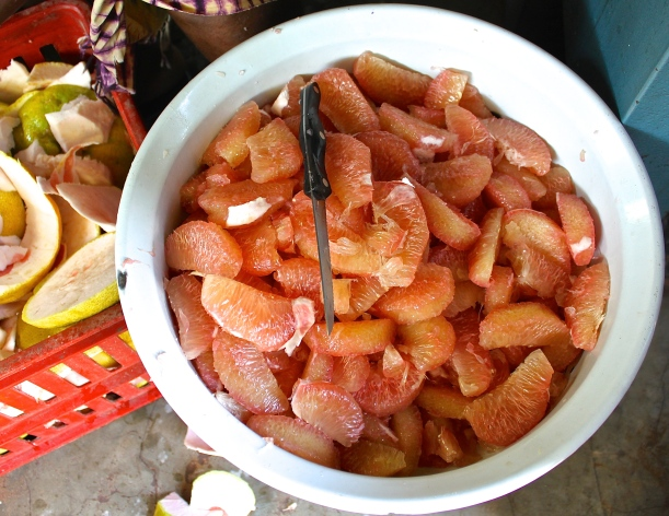 Preparing pomelos for juicing.