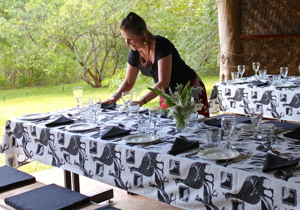 Preparing the tables for a farm lunch in the lodge.