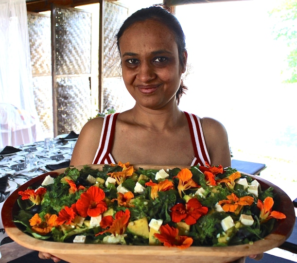 Mansi Vasiwala, a visitor from Livingstone, displays one of our fresh garden salads.
