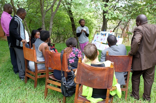 An HIV advocacy workshop being held under the trees of our lodge.