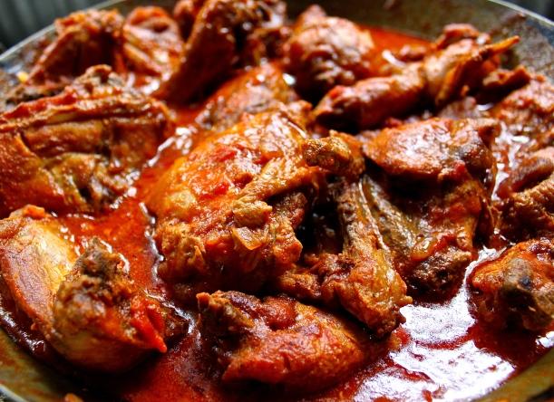 Nkunku with tomato and onion sauce.