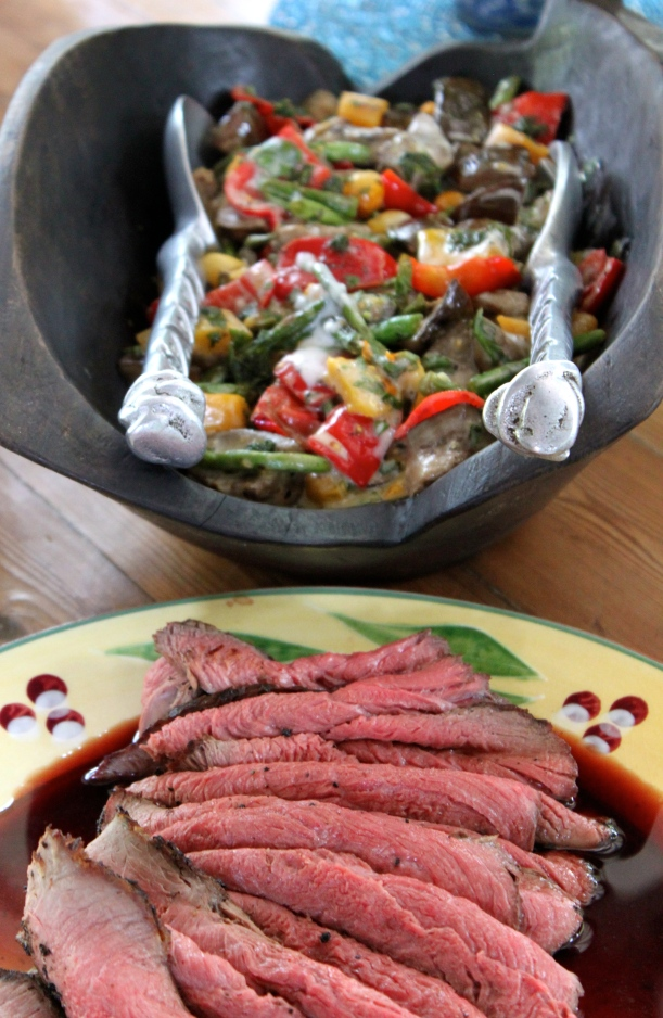 Rare rump steak with a grilled vegetable salad.