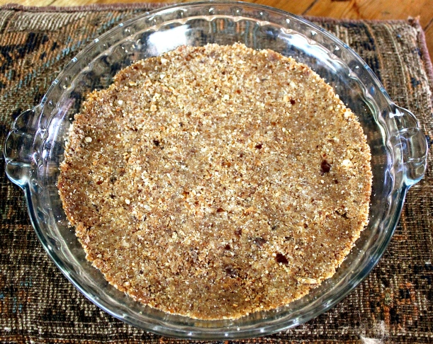 The pie crust, made from roasted pecans, coconut chips and dates.