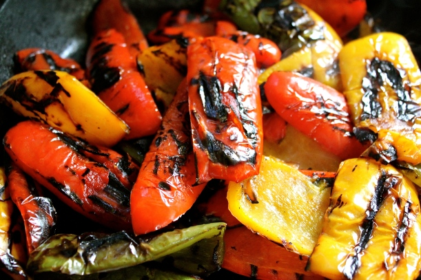 Roasted peppers after blackening the skin over the gas hob.
