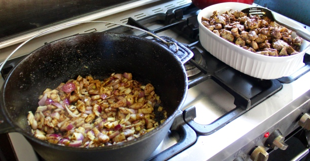 Softening the onions after browning the meat.