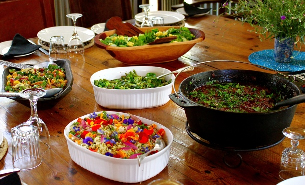 Sunday lunch on the farm with the lamb tagine, edible flower couscous and various salads.